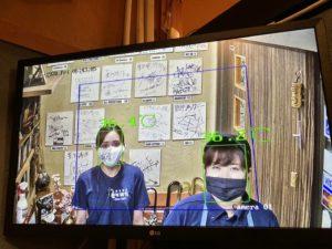 AIサーマルカメラに映る豊年満作女性スタッフ